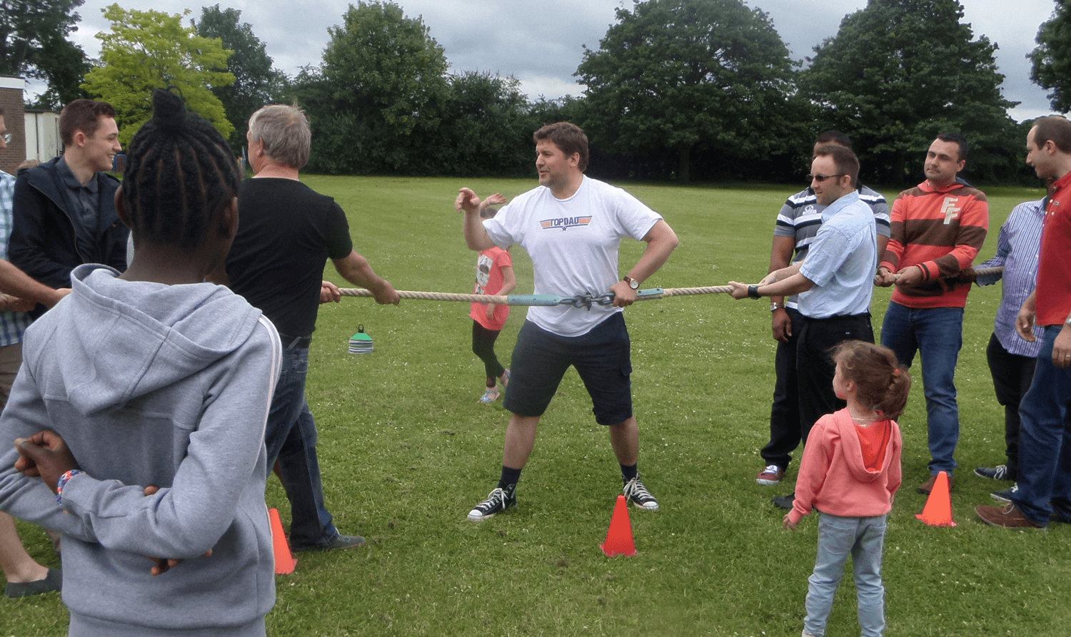 Mark refereeing a Tug-of-War at his local church's Fathers' Day BBQ.